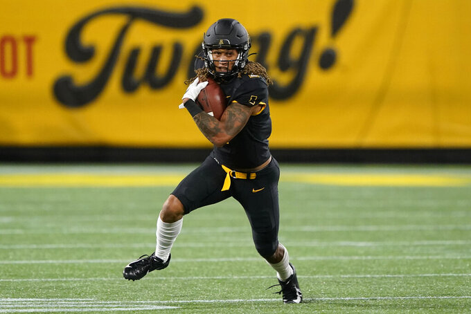 Appalachian State wide receiver Corey Xavier Sutton runs with the ball against East Carolina during the first half of an NCAA college football game Thursday, Sept. 2, 2021, in Charlotte, N.C. (AP Photo/Chris Carlson)