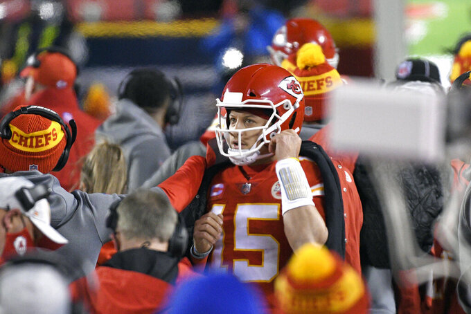 Kansas City Chiefs quarterback Patrick Mahomes stands on the sideline during the first half of the AFC championship NFL football game against the Buffalo Bills, Sunday, Jan. 24, 2021, in Kansas City, Mo. (AP Photo/Reed Hoffmann)