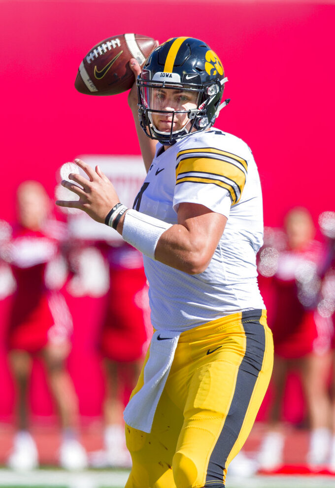 Iowa quarterback Nate Stanley (4) throws a pass during the second half of an NCAA college football game against Indiana, Saturday, Oct. 13, 2018, in Bloomington, Ind. Iowa won 42-16. (AP Photo/Doug McSchooler)