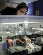 "In this Tuesday, Oct. 8, 2019, photo Spike Babaian, owner of several Vape New York stores, works in her East Harlem store in New York. Sales at small businesses that sell vaping products have plunged since August, when reports of vaping-related illnesses and deaths began. ""We can never undo the government going on the news and saying it's not safe to vape. The damage has been done,"" says Babaian, who has been in business for eight years.  (AP Photo/Bebeto Matthews)"
