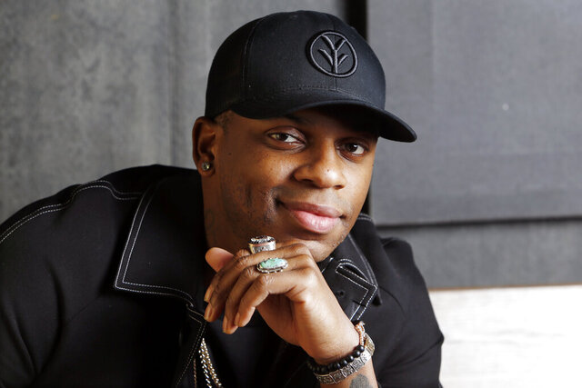 "FILE - Country singer Jimmie Allen poses in Nashville, Tenn. on Jan. 22, 2019.  Allen is nominated for best new artist at this year's CMA Awards. He'll perform his hit song ""Best Shot,"" which made history when Allen became the first Black artist to launch his career with a No. 1 single on the Billboard Country Airplay chart. (AP Photo/Mark Humphrey, File)"