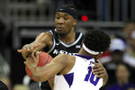 TCU forward Diante Smith (10) is called for traveling when he ran into Kansas State forward Xavier Sneed, back, during the first half of an NCAA college basketball game in the first round of the Big 12 men's basketball tournament in Kansas City, Mo., Wednesday, March 11, 2020. (AP Photo/Orlin Wagner)