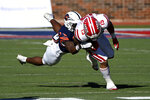 Louisiana-Lafayette running back Elijah Mitchell (15) runs through a tackle attempt by UTSA safety Rashad Wisdom in the first quarter during the First Responder Bowl NCAA college football game in Dallas, Saturday, Dec. 26, 2020. (AP Photo/Matt Strasen)