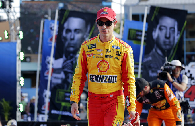 Joey Logano is introduced before a NASCAR Cup Series Championship auto race at the Homestead-Miami Speedway, Sunday, Nov. 18, 2018, in Homestead, Fla. (AP Photo/Terry Renna)