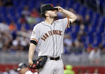 San Francisco Giants starting pitcher Andrew Suarez adjusts his cap during the fourth inning of the team's baseball game against the Miami Marlins, Wednesday, June 13, 2018, in Miami. (AP Photo/Lynne Sladky)