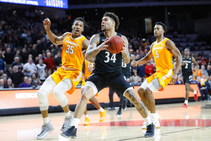 Cincinnati's Jarron Cumberland (34) drives against Tennessee's Yves Pons (35) during the second half of an NCAA college basketball game, Wednesday, Dec. 18, 2019, in Cincinnati. (AP Photo/John Minchillo)