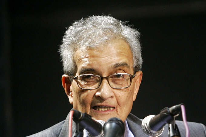 """FILE - In this Monday, Feb. 23, 2009 file photo, Nobel Prize-winning economist Amartya Sen delivers a lecture on """"Economics, Politics and Our Lives"""" in Calcutta, India. Sen, the economist who studied the causes of famines, will be recognized with this year's Princess of Asturias award in the Social Sciences category, it was announced Wednesday, May 26, 2021. The 87-year-old economist and philosopher has devoted his career to studying poverty and theories of human development. (AP Photo/Bikas Das, file)"""