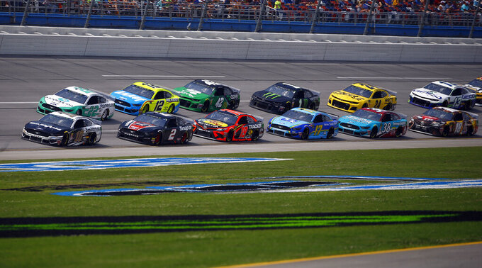 Aric Almirola (10) leads the pack as he wins Stage 1 during a NASCAR Cup Series auto race at Talladega Superspeedway, Sunday, April 28, 2019, in Talladega, Ala. (AP Photo/Butch Dill)