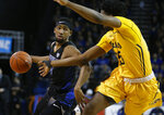Buffalo guard CJ Massinburg (5) drives against Kent State forward Philip Whittington (25) during the first half of an NCAA college basketball game, Friday, Feb. 22, 2019, in Buffalo, N.Y. (AP Photo/Jeffrey T. Barnes)