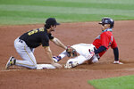 Pittsburgh Pirates' Adam Frazier (26) tags out Cleveland Indians' Francisco Lindor attempting to stretch a single into a double during the third inning of a baseball game Saturday, Sept. 26, 2020, in Cleveland. (AP Photo/Ron Schwane)