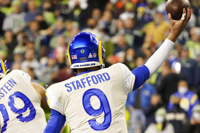 Los Angeles Rams quarterback Matthew Stafford (9) passes with tape on one of his fingers during the second half of an NFL football game against the Seattle Seahawks, Thursday, Oct. 7, 2021, in Seattle. (AP Photo/Elaine Thompson)