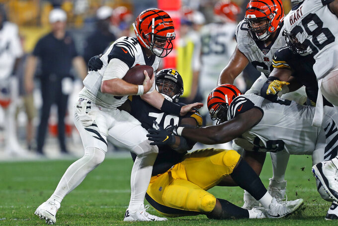 Pittsburgh Steelers nose tackle Javon Hargrave (79) sacks Cincinnati Bengals quarterback Andy Dalton (14) during the second half of an NFL football game in Pittsburgh, Monday, Sept. 30, 2019. (AP Photo/Tom Puskar)