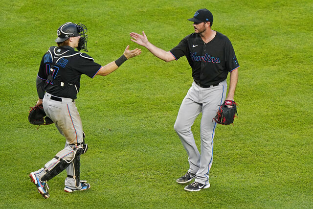 Miami Marlins catcher Chad Wallach (17) congratulates relief pitcher James Hoyt who replaced Daniel Castano in the ninth inning of their shutout of the New York Yankees in a baseball game Sunday, Sept. 27, 2020, at Yankee Stadium in New York. (AP Photo/Kathy Willens)