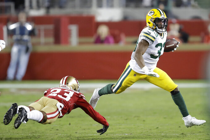 Green Bay Packers running back Aaron Jones (33) runs against San Francisco 49ers cornerback Ahkello Witherspoon (23) during the first half of an NFL football game in Santa Clara, Calif., Sunday, Nov. 24, 2019. (AP Photo/Ben Margot)