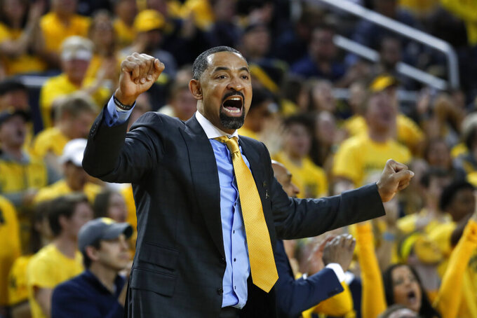 Michigan head coach Juwan Howard reacts to a call in the first half of an NCAA college basketball game against Michigan State in Ann Arbor, Mich., Saturday, Feb. 8, 2020. (AP Photo/Paul Sancya)