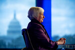 FILE - In this Aug. 14, 2019, file photo the Capitol Dome is visible in the window behind former Fed Chair Janet Yellen as she appears for an interview with FOX Business Network guest anchor Jon Hilsenrath in the Fox Washington bureau in Washington. In her first year as Federal Reserve chair, Yellen presided over a policy panel divided over the issue of how much longer the central bank could afford to keep its benchmark interest rate at a record low, and how to prepare financial markets for the start of rate hikes. (AP Photo/Andrew Harnik, File)