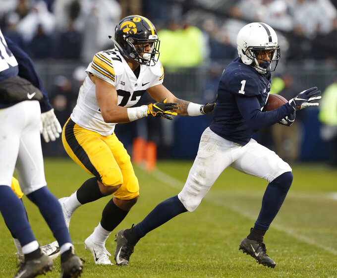No. 17 Penn State escapes No. 18 Iowa 30-24 with late stands