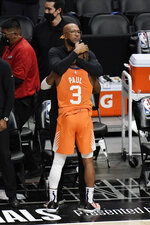 Phoenix Suns head coach Monty Williams hugs Chris Paul as they celebrate in the final seconds of Game 6 of the NBA basketball Western Conference Finals Wednesday, June 30, 2021, in Los Angeles. The Sun won 130-103. (AP Photo/Jae C. Hong)