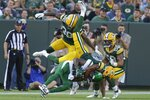 Green Bay Packers' Bronson Kaufusi stops New York Jets' Keelan Cole during the second half of a preseason NFL football game Saturday, Aug. 21, 2021, in Green Bay, Wis. (AP Photo/Matt Ludtke)