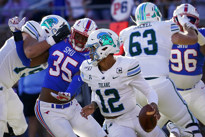 Tulane quarterback Justin McMillan (12) scrambles away from SMU defensive end Delontae Scott (35) during the first half of an NCAA football game at Ford Stadium on Saturday, Nov. 30, 2019, in Dallas. (Smiley N. Pool/The Dallas Morning News via AP)