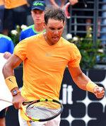 Spain's Rafael Nadal celebrates after winning his match against Bosnia's Damir Dzumhur at the Italian Open tennis tournament in Rome, Wednesday, May 16, 2018. (Ettore Ferrari/ANSA via AP)