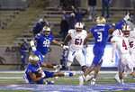 Tulsa linebacker Zaven Collins (23) slides after an interception against SMU late in the second half of an NCAA college football game in Tulsa, Okla., Saturday, Nov. 14, 2020. (AP Photo/Joey Johnson)