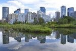 The Calgary, Alberta, Canada skyline is seen from Prince Island on July 2, 2019. A 2017 pilot study of tap water at 150 daycares in the province showed 18 had lead levels in drinking water at or above 5 ppb, which the researchers considered risky for the infants and toddlers. The highest was 35.5 ppb. (Mackenzie Lad/Institute for Investigative Journalism/Concordia University via AP)