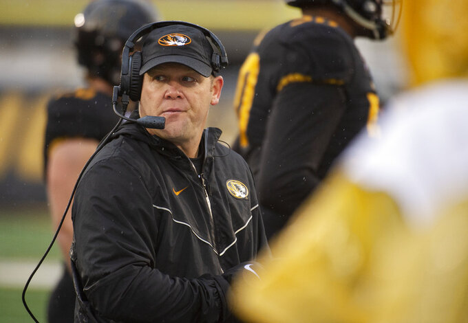 Missouri head coach Barry Odom watches his team play during the first half of an NCAA college football game against Arkansas Friday, Nov. 23, 2018, in Columbia, Mo. (AP Photo/L.G. Patterson)