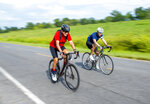 Phil Baker, left, a lifelong athlete who turns 80 on Aug. 28, begins his bicycle ride with his co-rider Britt Drummond, right, Tuesday Aug. 24, 2021, in Baton Rouge, La. Baker is celebrating his 80th birthday by cycling 80 miles a day for 10 days straight.(Bill Feig/The Advocate via AP)