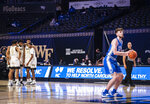 Duke forward Matthew Hurt shoots a free throw after Wake Forest coach Steve Forbes was assessed double technical fouls and ejected during an NCAA college basketball game Wednesday, Feb. 17, 2021, in Wintson-Salem, N.C. (Andrew Dye/The Winston-Salem Journal via AP, Pool)