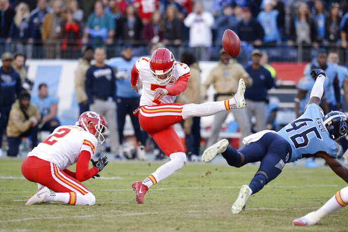 Tennessee Titans defensive back Joshua Kalu (46) blocks a 52-yard field goal attempt by Kansas City Chiefs kicker Harrison Butker (7) on the final play of an NFL football game Sunday, Nov. 10, 2019, in Nashville, Tenn. The Titans won 35-32. (AP Photo/Mark Zaleski)