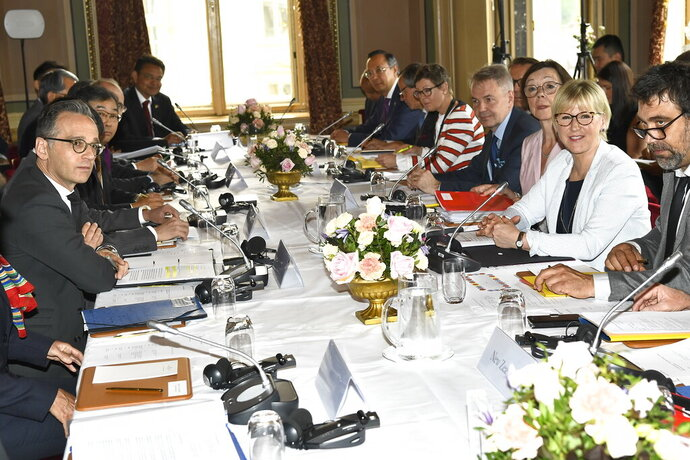 Sweden's Foreign Minister Margot Wallstrom, second right, hosts the meeting on nuclear disarmament and the non-proliferation treaty, at the Grand Hotel in Stockholm, Tuesday June 11, 2019. (Claludio Bresciani/TT via AP)