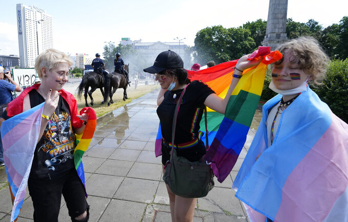 People walk towards the starting point of the Equality Parade, an LGBT pride parade, in Warsaw, Poland, Saturday, June 19, 2021.(AP Photo/Czarek Sokolowski)
