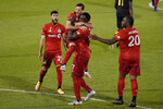 Toronto FC's Pablo Piatti leaps into the arms of Jozy Altidore after Altidore scored a goal as teammates  Jonathan Osorio, left, and Ayo Akinola, right, celebrate with them during the second half of an MLS soccer match against the Columbus Crew, Sunday, Sept. 27, 2020, in East Hartford, Conn. (AP Photo/Jessica Hill)