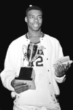 FILE - In this Dec. 30, 1959, file photo, Cincinnati's Oscar Robertson poses with the Most Valuable Player award after leading his team to the ECAC Holiday Festival Championship at New York's Madison Square Garden. Cincinnati defeated Iowa 96-83. Four of the top five tournament triple-doubles pre-1986 belong to Robertson. (AP Photo/File)