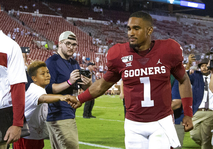 Oklahoma quarterback Jalen Hurts (1) greets a fan following an NCAA college football game against Houston in Norman, Okla., Sunday, Sept. 1, 2019. Oklahoma won 49-31. (AP Photo/Alonzo Adams)
