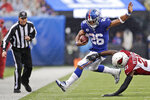 Arizona Cardinals' Patrick Peterson, right, defends against New York Giants' Saquon Barkley during the first half of an NFL football game, Sunday, Oct. 20, 2019, in East Rutherford, N.J. (AP Photo/Adam Hunger)