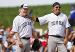FILE - In this June 14, 2014, file photo, actors Kevin Costner, right, and Timothy Busfield joke around at first base during a celebrity softball game at the Field of Dreams in Dyersville, Iowa. The 1989 film