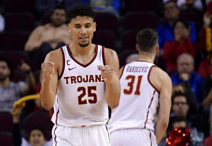 Southern California forward Bennie Boatwright, left, celebrates after forward Nick Rakocevic, right, scored during the second half of an NCAA college basketball game against UCLA Saturday, Jan. 19, 2019, in Los Angeles. USC won 80-67. (AP Photo/Mark J. Terrill)