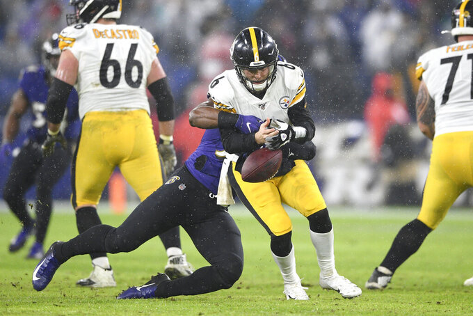 Pittsburgh Steelers quarterback Devlin Hodges, center, fumbles the ball on a strip sack by Baltimore Ravens outside linebacker Matt Judon, back, during the first half of an NFL football game, Sunday, Dec. 29, 2019, in Baltimore. The Ravens recovered the fumble. (AP Photo/Nick Wass)