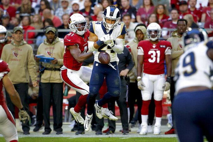 Arizona Cardinals running back Kenyan Drake (41) breaks up a pass intended for Los Angeles Rams safety Taylor Rapp (24) during the first half of an NFL football game, Sunday, Dec. 1, 2019, in Glendale, Ariz. (AP Photo/Rick Scuteri)