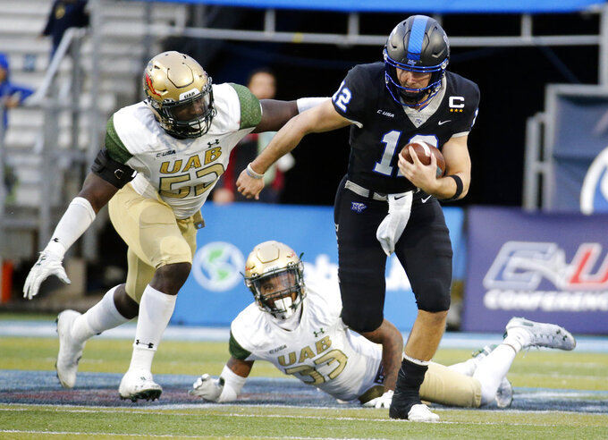 Middle Tennessee quarterback Brent Stockstill (12) is chased by UAB linebacker Fitzgerald Mofor (52) after getting past cornerback Brontae Harris (33) in the second half of the NCAA Conference USA championship college football game Saturday, Dec. 1, 2018, in Murfreesboro, Tenn. UAB won 27-25. (AP Photo/Mark Humphrey)