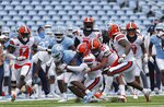 Syracuse defenders swarm to bring down North Carolina's Michael Carter (8) in the first half of an NCAA college football game Saturday, Sept. 12, 2020, in Chapel Hill, N.C. Fans have been prohibited from attending the game due to the COVID-19 pandemic. (Robert Willett/The News & Observer via AP, Pool)