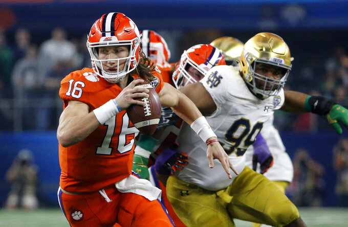 FILE - In this Dec. 29, 2018, file photo, Clemson quarterback Trevor Lawrence (16) scrambles out of the pocket during the NCAA Cotton Bowl playoff semifinal football game against Notre Dame in Arlington, Texas. The Tigers' freshman quarterback has all the physical gifts. From that standpoint, he is ready for Alabama. The challenge against the Tide for Lawrence will be as much mental as physical.(AP Photo/Michael Ainsworth, File)