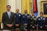 Secretary of Defense Mark Esper, left, speaks after a ceremony to swear in Gen. Charles Q. Brown Jr., as Chief of Staff of the Air Force, in the Oval Office of the White House, Tuesday, Aug. 4, 2020, in Washington. (AP Photo/Alex Brandon)