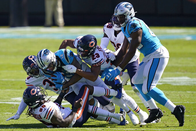 A host of Chicago Bears defenders tackle Carolina Panthers wide receiver D.J. Moore (12) during the first half of an NFL football game in Charlotte, N.C., Sunday, Oct. 18, 2020. (AP Photo/Brian Blanco)