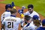 Milwaukee Brewers' Ryan Braun is congratulated after hitting a game-winning sacrifice fly during the ninth inning of a baseball game against the Chicago Cubs Friday, Sept. 11, 2020, in Milwaukee. The Brewers won 1-0. (AP Photo/Morry Gash)