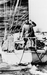 FILE - In this April 21, 1969, file photo, Robin Knox-Johnston waves from the bow of his 32-foot yacht Suhaili as he passes Bishop Rock Lighthouse off the coast of the Isles of Scilly, England. Monday, April 22, 2019, commemorates the 50th anniversary of the finish, when Knox-Johnston achieved the nautical equivalent of climbing Mount Everest when he became the first man to sail alone around the world nonstop. (AP Photo/File)
