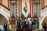 Bolivia's interim President Jeanine Anez, left, sits next to President of the Senate Monica Eva Copa to enact a law to hold new elections in La Paz, Bolivia, Sunday, Nov. 24, 2019. Bolivia is struggling to stabilize after weeks of anti-government protests and violence in which at least 30 people have been killed. Former president Evo Morales resigned on Nov. 10 after an election that the opposition said was rigged. (AP Photo/Juan Karita)