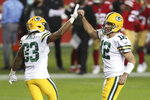 Green Bay Packers quarterback Aaron Rodgers (12) is congratulated by running back Aaron Jones (33) after throwing a touchdown pass to Marcedes Lewis during the first half of an NFL football game against the San Francisco 49ers in Santa Clara, Calif., Thursday, Nov. 5, 2020. (AP Photo/Jed Jacobsohn)